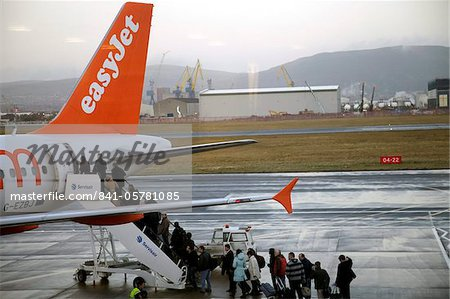 Easyjet passengers boarding at Belfast City airport, Belfast, Ulster, Northern Ireland, United Kingdom, Europe Stock Photo - Rights-Managed, Image code: 841-05781085