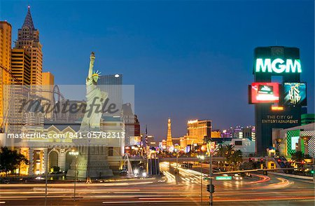 New York-New York hotel with roller coaster, and light trails at night of traffic at the intersection of The Strip, Las Vegas Boulevard South and West Tropicana Avenue, Las Vegas, Nevada, United States of America, North America Stock Photo - Rights-Managed, Image code: 841-05782313