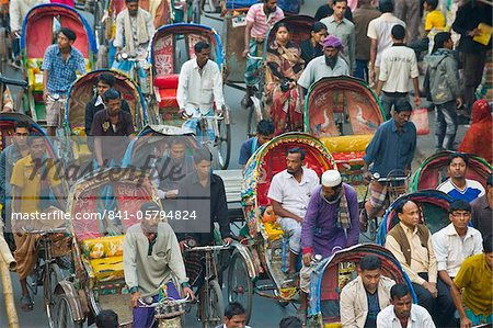 Busy rickshaw traffic on a street crossing in Dhaka, Bangladesh, Asia Stock Photo - Rights-Managed, Image code: 841-05794824