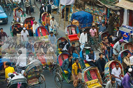 Busy rickshaw traffic on a street crossing in Dhaka, Bangladesh, Asia Stock Photo - Rights-Managed, Image code: 841-05794825