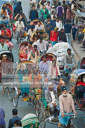 Busy rickshaw traffic on a street crossing in Dhaka, Bangladesh, Asia Stock Photo - Rights-Managed, Image code: 841-05794826