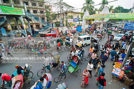 Busy rickshaw traffic on a street crossing in Dhaka, Bangladesh, Asia Stock Photo - Rights-Managed, Image code: 841-05794829