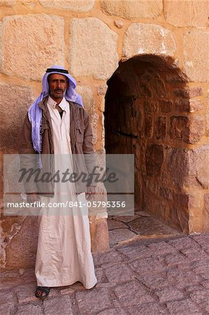 The gate keeper stands by the single entrance to the UNESCO World Heritage Site of St. Catherine's Monastery, Sinai Peninsula, Egypt, North Africa, Africa Stock Photo - Rights-Managed, Image code: 841-05795356