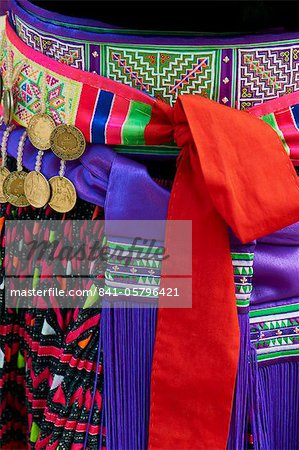 Detail of traditional dress of Hmong woman, Lao New Year Festival, Luang Prabang, Laos, Indochina, Southeast Asia, Asia Stock Photo - Rights-Managed, Image code: 841-05796421
