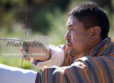 Local man taking part in archery competition using traditional bow, Jakar, Bumthang, Bhutan, Asia Stock Photo - Rights-Managed, Image code: 841-05845870