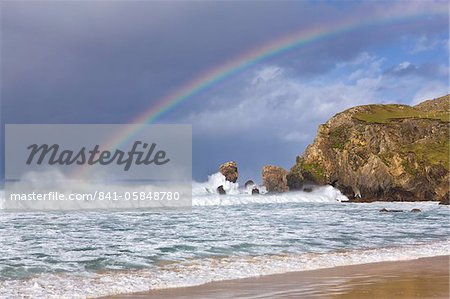 Sea stacks, rainbow, stormy clouds and rough seas on a windy afternoon at Dalmore Bay on the Isle of Lewis, Outer Hebrides, Scotland, United Kingdom, Europe Stock Photo - Rights-Managed, Image code: 841-05848780