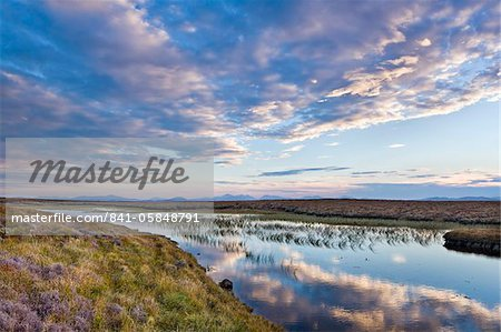 Evening reflections in a lochan on the peaty moreland of Lewis, with the mountains of Harris in the distance, Isle of Lewis, Outer Hebrides, Scotland, United Kingdom, Europe Stock Photo - Rights-Managed, Image code: 841-05848791