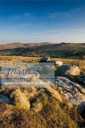 Granite outcrops in Dartmoor National Park, looking across to Hound Tor and Hay Tor on the horizon, Devon, England, United Kingdom, Europe Stock Photo - Rights-Managed, Image code: 841-05962557