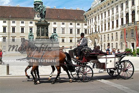 Horse-drawn carriage at the Hofburg, UNESCO World Heritage Site, Vienna, Austria, Europe Stock Photo - Rights-Managed, Image code: 841-06030492