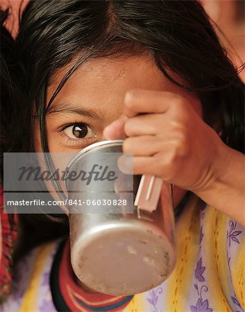 Young girl drinking from metal cup, Pokhara, Nepal, Asia Stock Photo - Rights-Managed, Image code: 841-06030828