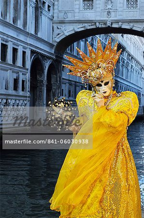 Masked figure in costume at the 2012 Carnival, with Ponte di Sospiri in the background, Venice, Veneto, Italy, Europe Stock Photo - Rights-Managed, Image code: 841-06030938