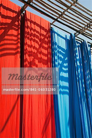 Freshly dyed fabric hanging to dry, Sari garment factory, Rajasthan, India, Asia Stock Photo - Rights-Managed, Image code: 841-06031280