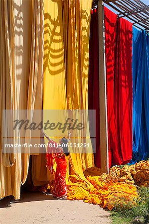 Woman in sari checking the quality of freshly dyed fabric hanging to dry, Sari garment factory, Rajasthan, India, Asia Stock Photo - Rights-Managed, Image code: 841-06031281