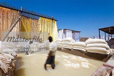 Washing fabric in a bleaching pool, Sari garment factory, Rajasthan, India, Asia Stock Photo - Rights-Managed, Image code: 841-06031287