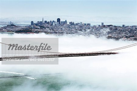 Golden Gate Bridge and the San Francisco skyline floating above the fog on a foggy day in San Francisco, California, United States of America, North America Stock Photo - Rights-Managed, Image code: 841-06031317