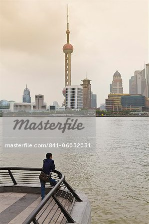 A man looking at the Oriental Pearl Tower and Pudong skyline across the Huangpu River from the Bund, Shanghai, China, Asia Stock Photo - Rights-Managed, Image code: 841-06032031