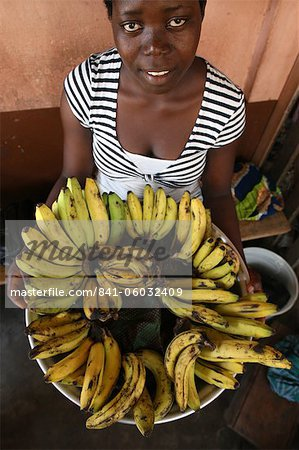 Girl selling bananas, Lome, Togo, West Africa, Africa Stock Photo - Rights-Managed, Image code: 841-06032409