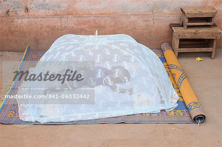 Baby sleeping under a mosquito net, Lome, Togo, West Africa, Africa Stock Photo - Rights-Managed, Image code: 841-06032442