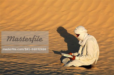 Beduin reading the Koran in the Sahara, Douz, Kebili, Tunisia, North Africa, Africa Stock Photo - Rights-Managed, Image code: 841-06032466