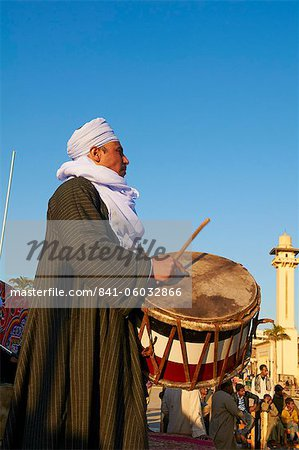 Drummer at Tahtib demonstration, a traditional form of Egyptian folk dance involving a wooden stick, also known as stick dance or cane dance, Mosque of Abu el-Haggag, Luxor, Egypt, North Africa, Africa Stock Photo - Rights-Managed, Image code: 841-06032866