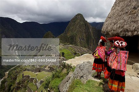 Traditionally dressed children looking over the ruins of the Inca city of Machu Picchu, UNESCO World Heritage Site, Vilcabamba Mountains, Peru, South America Stock Photo - Rights-Managed, Image code: 841-06034484