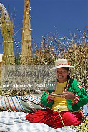 Portrait of a Uros Indian woman, Islas Flotantes (Floating Islands), Lake Titicaca, Peru, South America Stock Photo - Rights-Managed, Image code: 841-06034487