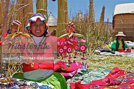 Portrait of a Uros Indian woman selling souvenirs, Islas Flotantes (Floating Islands), Lake Titicaca, Peru, South America Stock Photo - Rights-Managed, Image code: 841-06034488