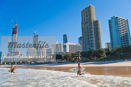 Surfers heading out to surf at Surfers Paradise beach, the Gold Coast, Queensland, Australia, Pacific Stock Photo - Rights-Managed, Image code: 841-06341109