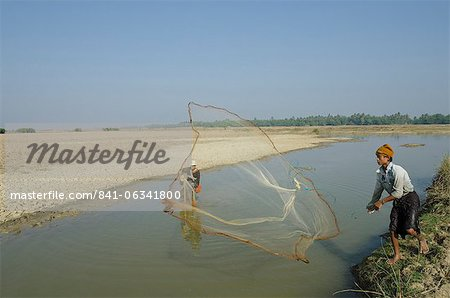 Youngster fishing with fishing net in a waterway, Irrawaddy delta, Myanmar (Burma), Asia Stock Photo - Rights-Managed, Image code: 841-06341800