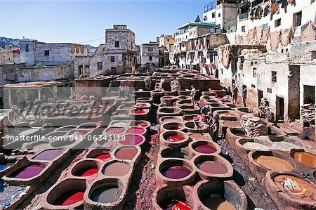 Chouwara traditional leather tannery in Old Fez, vats for tanning and dyeing leather hides and skins, Fez, Morocco, North Africa, Africa Stock Photo - Rights-Managed, Image code: 841-06343118