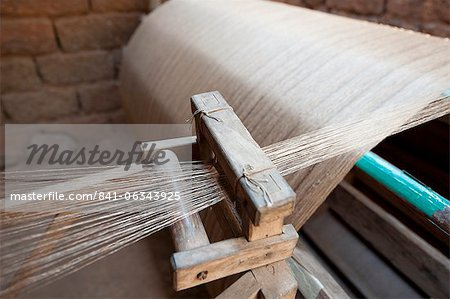 Silk thread being spun on large handmade wooden wheel, rural Orissa, India, Asia Stock Photo - Rights-Managed, Image code: 841-06343925