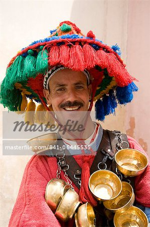 A water seller dressed in traditional Berber dress in Marrakech, Morocco, North Africa, Africa Stock Photo - Rights-Managed, Image code: 841-06445535