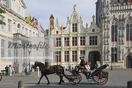 A horse drawn carriage crosses the Burg Square, passing the Stadhuis (Town Hall) buildings, Brugge, Belgium, Europe Stock Photo - Rights-Managed, Image code: 841-06446256