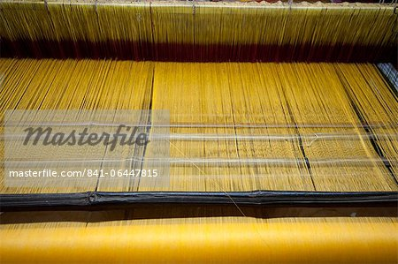 Yellow dyed silk being woven on loom, Naupatana weaving village, rural Orissa, India, Asia Stock Photo - Rights-Managed, Image code: 841-06447815