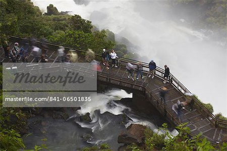 Tourists crossing bridge at foot of Bossetti Falls, Iguazu Falls, Iguazu National Park, UNESCO World Heritage Site, Misiones, Argentina, South America Stock Photo - Rights-Managed, Image code: 841-06501835