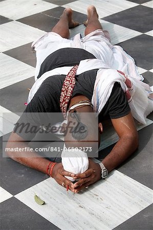 Hare Krishna devotee prostrating on the temple floor, Vrindavan, Uttar Pradesh, India, Asia Stock Photo - Rights-Managed, Image code: 841-06502173
