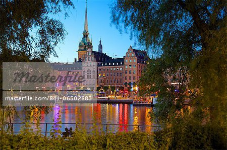 Gamla Stan and Riddarholmen with spire of Riddarholmskyrkan (Riddarholmen Church) at dusk, Stockholm, Sweden, Scandinavia, Europe Stock Photo - Rights-Managed, Image code: 841-06502883
