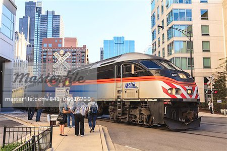 Metra Train passing pedestrians at an open railroad crossing, Downtown, Chicago, Illinois, United States of America, North America Stock Photo - Rights-Managed, Image code: 841-06616700