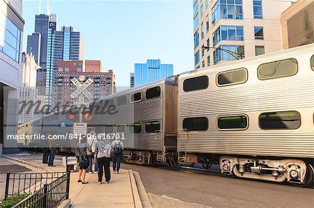 Metra Train passing pedestrians at an open railroad crossing, Downtown, Chicago, Illinois, United States of America, North America Stock Photo - Rights-Managed, Image code: 841-06616701