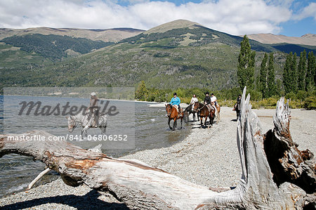 Horseback riding by Guttierez Lake in Estancia Peuma Hue, Patagonia, Argentina, South America Stock Photo - Rights-Managed, Image code: 841-06806252