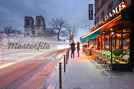 Tourists stop to photograph Notre Dame de Paris cathedral at dawn, Paris, France, Europe Stock Photo - Rights-Managed, Image code: 841-06807828