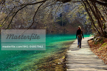 Visitor on wooden walkway path over Crystal Clear Waters of Plitvice Lakes National Park, UNESCO World Heritage Site, Plitvice, Croatia, Europe Stock Photo - Rights-Managed, Image code: 841-06807962