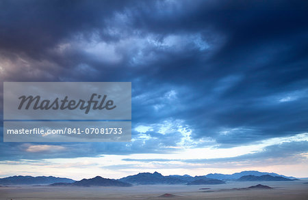 View at dusk over the magnificent landscape of the Namib Rand game reserve, Namib Naukluft Park, Namibia, Africa Stock Photo - Rights-Managed, Image code: 841-07081733