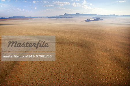 Aerial view from hot air balloon over magnificent desert landscape of sand dunes, mountains and Fairy Circles, Namib Rand game reserve Namib Naukluft Park, Namibia, Africa Stock Photo - Rights-Managed, Image code: 841-07081750