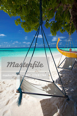 Swing and traditional boat on tropical beach, Maldives, Indian Ocean, Asia Stock Photo - Rights-Managed, Image code: 841-07082744
