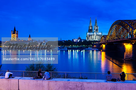 Rhine bridge and Cathedral of Cologne above the River Rhine at night, Cologne, North Rhine bridge and Cathedral of Cologne above the River Rhine at night, Cologne, North Rhine-Westphalia, Germany, Europe Stock Photo - Rights-Managed, Image code: 841-07083489