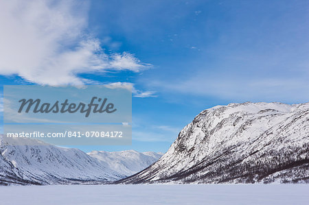 Mountains flank a frozen lake in Mosstrond, near the Hardanger Plateau, Norway, Scandinavia, Europe Stock Photo - Rights-Managed, Image code: 841-07084172