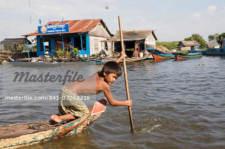 Young boy in a boat on Tonle Sap Lake, Cambodia, Indochina, Southeast Asia, Asia Stock Photo - Rights-Managed, Image code: 841-07202316