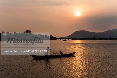 Father and son fishing on Kampong Bay River at sunset, Kampot, Cambodia, Indochina, Southeast Asia, Asia Stock Photo - Rights-Managed, Image code: 841-07202638