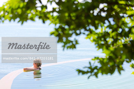 Woman in an infinity pool looking out to sea, Koh Samui, Thailand, Southeast Asia, Asia Stock Photo - Rights-Managed, Image code: 841-07205181